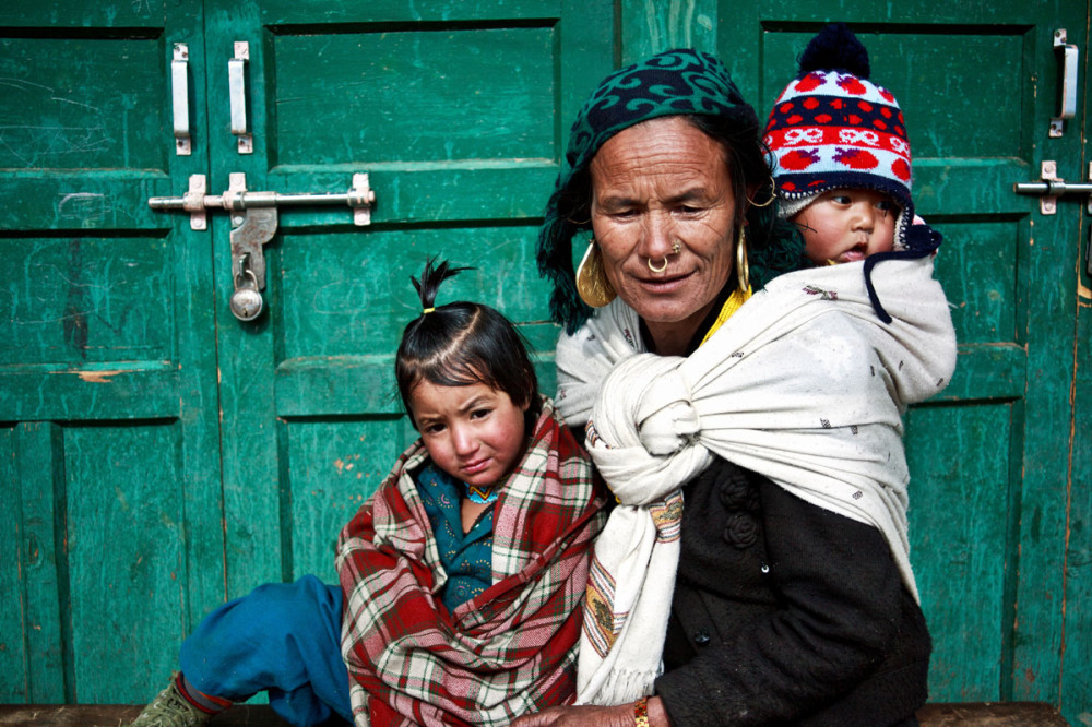 Thakuri woman with the  children in far west Nepal.