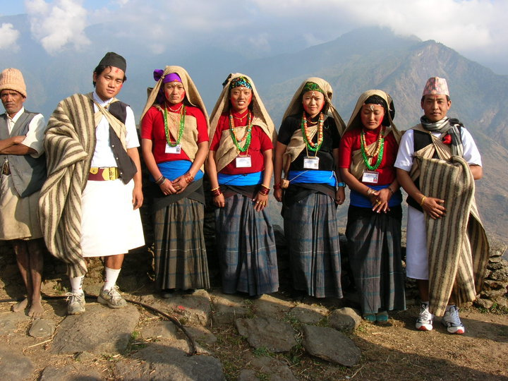 A group of Gurung people in traditional costumes.