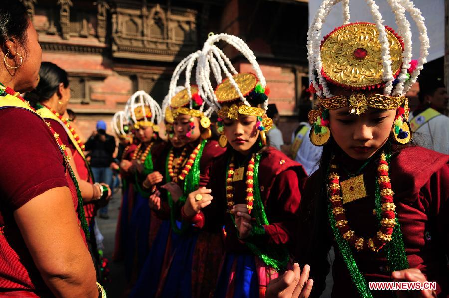 Gurung girls wearing traditional costumes dance during the New Year parade of Tamu Losar in Kathmandu.