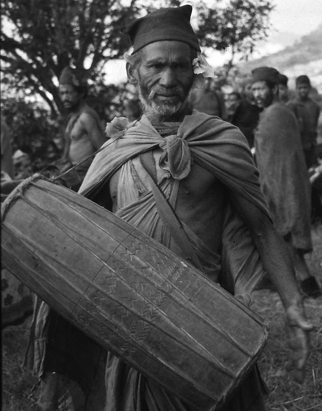 A Raute Man with traditional musical isntrument