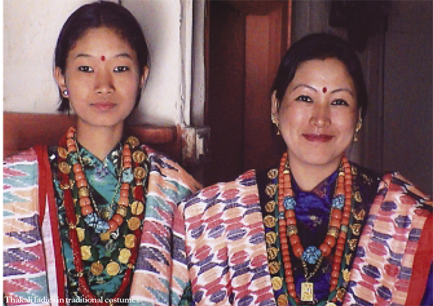 Two Thakali women in traditional dress.