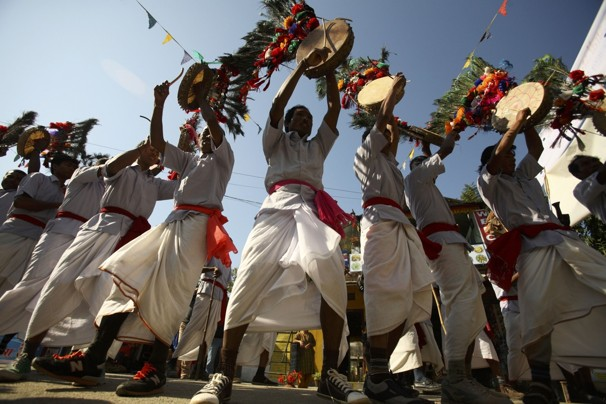 Tharu men performing traditional dance.