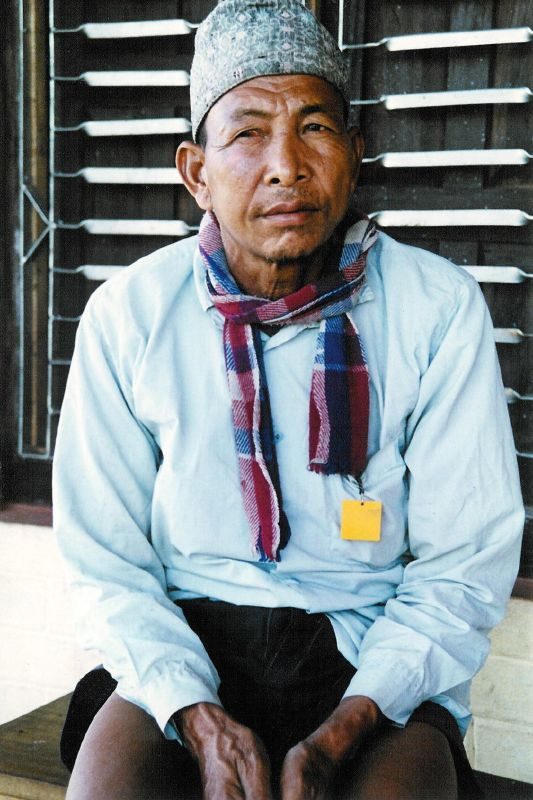 A Tharu man with a traditional Nepali cap