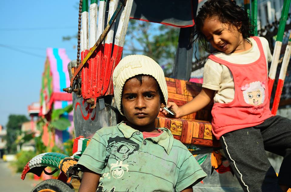 """I don't want to be a rickshaw driver when I grow up. I see my father get upset when he has a scuffle with a customer refusing the pay."" What do you want to be when you grow up? ""I want to be rich. Rich like her family"" She your friend? ""No she's our landlord's daughter."" - Ram Mahato, Krishnapur, Chitwan"